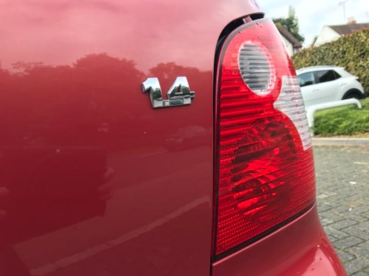 Red Volkswagen Polo S 2002